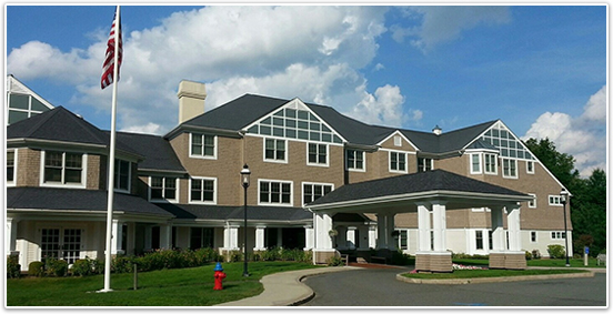 The outside of Hoffman SummerWood features an awning with ground floor patios.